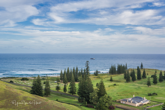 The picturesque Norfolk Island Golf Club and course facing the sea , located beside the cemetery.